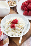 Cottage cheese with fresh raspberry, vertical. Top view Royalty Free Stock Photography