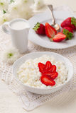 Cottage cheese with fresh strawberries and cream jug Royalty Free Stock Photo