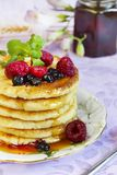 Cottage cheese fritters with honey and berries Royalty Free Stock Photo
