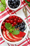 Cottage cheese with fruit, berries, flax seeds and Chia seeds. Red currant, peach, blueberry, mint Royalty Free Stock Images