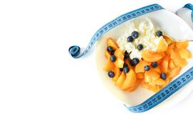 Cottage cheese and fruit and measuring tape. selective focus. Diet concept. Healthy and fiber breakfast, slimming food. stock photos