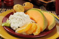 Cottage cheese with fruit and muffins Stock Images