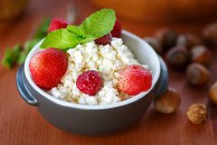 Cottage cheese with fruit and nuts Stock Photo