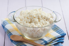 Cottage cheese in a glass with a wooden spoon, close-up, selecti Stock Photography