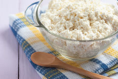 Cottage cheese in a glass with a wooden spoon, close-up, selecti Royalty Free Stock Photos