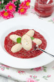 Cottage cheese gnocchi with strawberry sauce on a fork vertical Royalty Free Stock Images