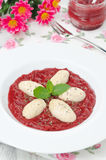 Cottage cheese gnocchi with strawberry sauce vertical Stock Photo