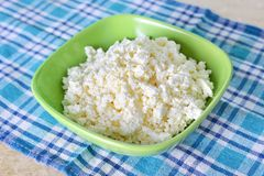Cottage cheese in green bowl Stock Images