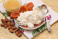 Cottage cheese, honey, dried apricots and almonds. Stock Image