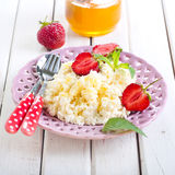 Cottage cheese with honey Royalty Free Stock Images
