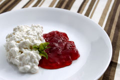 Cottage cheese and jam Stock Image