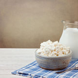 Cottage cheese and jug with milk on white wooden table. Jewish holiday Shavuot concept Stock Photos