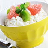 Cottage cheese with kiwi and grapefruit Royalty Free Stock Photo