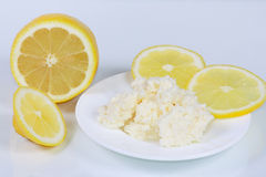 The cottage cheese and lemon. For healh Royalty Free Stock Image