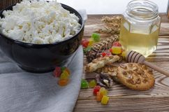 A healthy breakfast. cottage cheese are at the black plate on the wood background stock photos