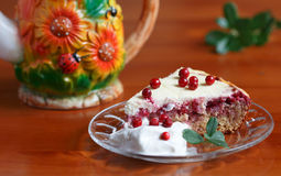 Cottage cheese lingonberry pie with vanilla creame. Lingonberry with quark, curd cheese;lingonberry leaf,teapot with flouers and beetle,ladybug Stock Images