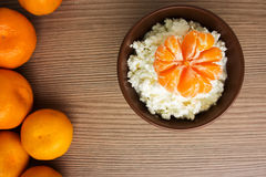 Cottage cheese with mandarin on wooden background Royalty Free Stock Photography