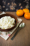 Cottage cheese with mandarin on wooden background Royalty Free Stock Photos