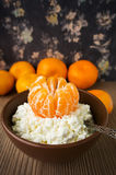 Cottage cheese with mandarin on wooden background Royalty Free Stock Images
