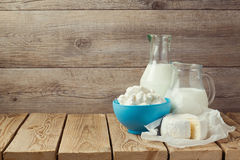 Cottage cheese and milk bottle over wooden background Stock Images