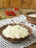 Cottage Cheese and milk in a clay pot. Cottage Cheese and milk in Royalty Free Stock Image