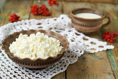 Cottage Cheese and milk in a clay pot. Cottage Cheese and milk in Stock Photos