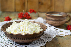 Cottage Cheese and milk in a clay pot. Cottage Cheese and milk in Royalty Free Stock Photo
