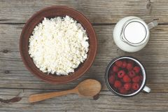 Useful dietary products. Cottage cheese, milk, raspberries. Cottage cheese, milk, raspberries Useful dietary products Royalty Free Stock Image