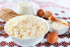 Cottage cheese, milk, sour cream, bread and eggs Royalty Free Stock Images