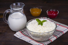 Cottage cheese and milk on the table. Stock Images