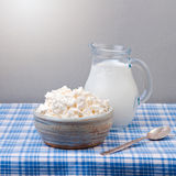 Cottage cheese and milk on tablecloth. Jewish holiday Shavuot concept Stock Photo