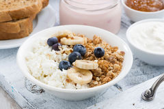 cottage cheese, muesli and fresh fruit for breakfast, closeup Royalty Free Stock Images