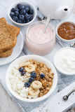 Cottage cheese, muesli and fresh fruit for healthy breakfast Royalty Free Stock Images