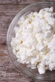 Cottage cheese on old wooden macro. view from above. vertical Royalty Free Stock Photography