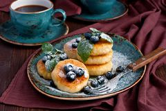 Curd pancakes with  berries and coffee cup Stock Photography
