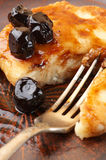 Cottage cheese pancake. With cherry conserve on brown plate Stock Images