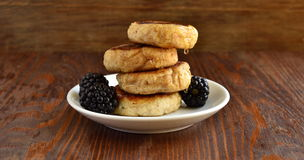 Cottage cheese pancake with honey and blackberries. Selective focus Royalty Free Stock Images