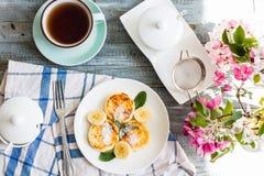 Cottage cheese pancakes with banana, powdered sugar and fresh mi Stock Image