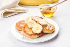 Cottage cheese pancakes with banana slices Royalty Free Stock Photo