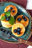 Cottage cheese pancakes with berries Stock Photography