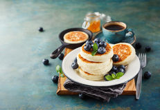 Cottage cheese pancakes with blueberries Stock Photos