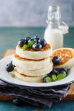 Cottage cheese pancakes with blueberries and mint Stock Photos