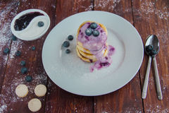 Cottage cheese pancakes with blueberry jam Royalty Free Stock Photo