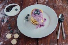 Cottage cheese pancakes with blueberry jam. Helthy breakfast with cottage cheese pancakes and nonfat yogurt blueberry Royalty Free Stock Photo