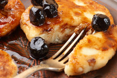 Cottage cheese pancakes. With cherry conserve on brown plate Stock Photo