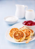 Cottage cheese pancakes with currant jam and sour cream Royalty Free Stock Photo