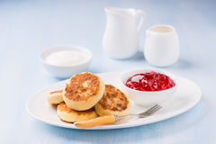 Cottage cheese pancakes with currant jam and sour cream Stock Photo
