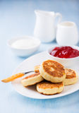 Cottage cheese pancakes with currant jam and sour cream Royalty Free Stock Image