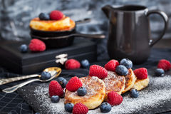 Cottage cheese pancakes decorated with fresh berries Stock Photo