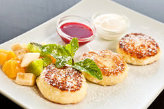 Cottage cheese pancakes with fruits Stock Photo